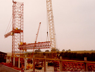 http://www.towercranes.com/Photo-Scans/29/Erection/3-jibs/29-20.jpg